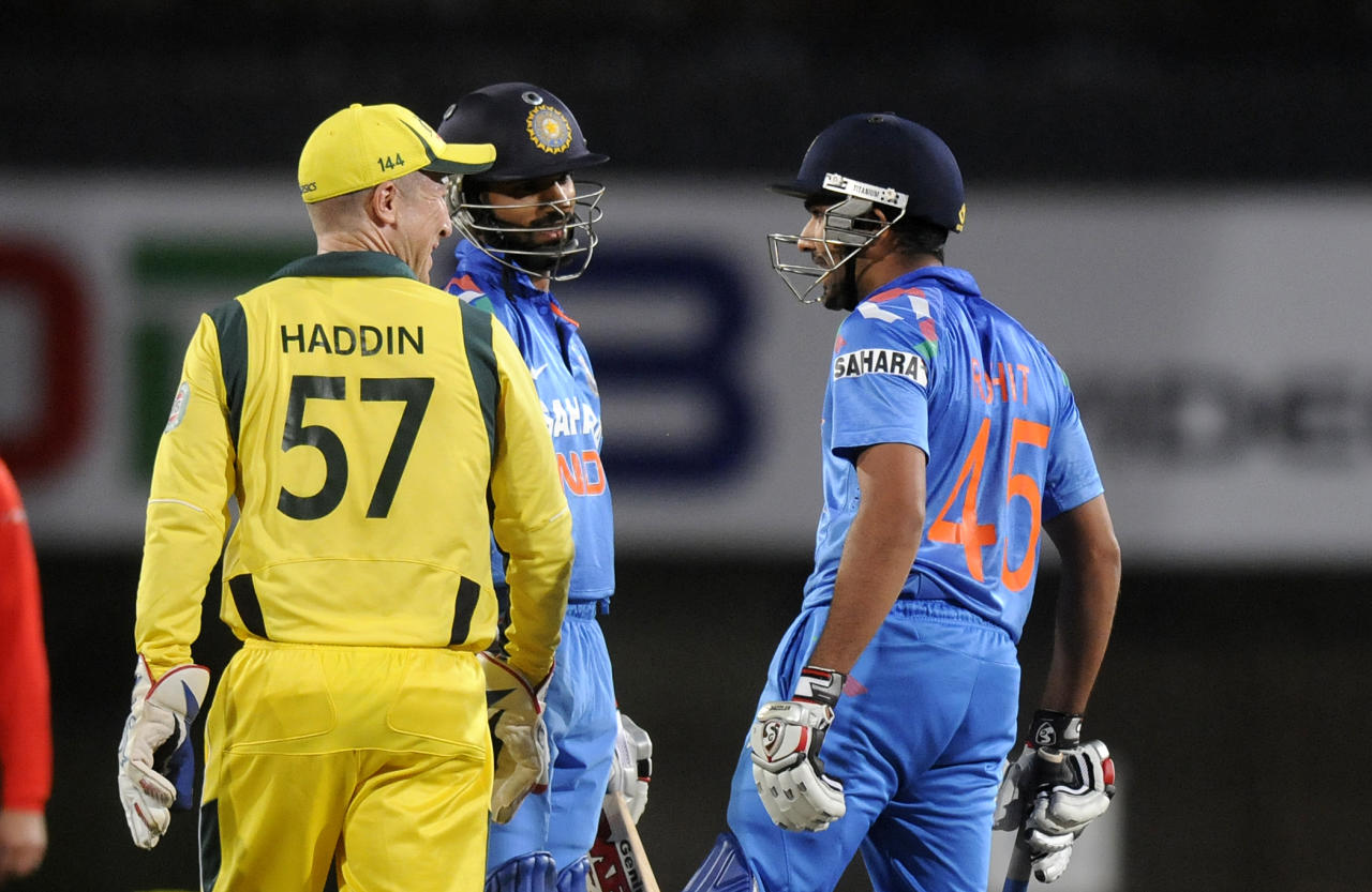 Brad Haddin of Australia exchanges a few words with Rohit Sharma of India during the fourth Star Sports Series One Day International (ODI) between India and Australia held at the JSCA International Cricket Stadium, Ranchi on the 23rd October 2013  Photo by Pal Pillai - BCCI - SPORTZPICS    Use of this image is subject to the terms and conditions as outlined by the BCCI. These terms can be found by following this link:  https://ec.yimg.com/ec?url=http%3a%2f%2fsportzpics.photoshelter.com%2fgallery%2fBCCI-Image-terms-and-conditions%2fG00004IIt7eWyCv4%2fC0000ubZaQCkIRgQ&t=1500929674&sig=fGkzXt.C9sIygyWuz9pA1Q--~C
