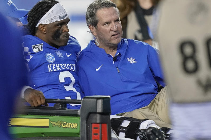 Kentucky quarterback Terry Wilson (3) is is carted off the field after being injured during the second half of an NCAA college football game between Kentucky and Eastern Michigan, Saturday, Sept. 7, 2019, in Lexington, Ky. Wilson was injured and left the game on a cart as a result of the play. (AP Photo/Bryan Woolston)