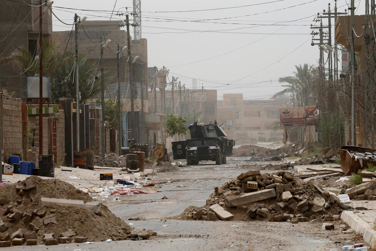<p>An Iraqi security forces' vehicle is seen on a street in the center of Fallujah, Iraq. (Photo: Thaier Al-Sudani/Reuters) </p>