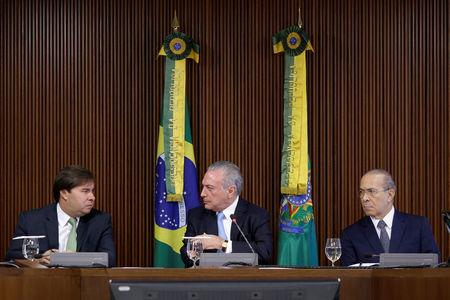President of the Chamber of Deputies Maia speaks with Brazil's president Temer near Brazil's Chief of Staff Minister Padilha during a meeting of the Pension Reform Commission at the Planalto Palace in Brasilia