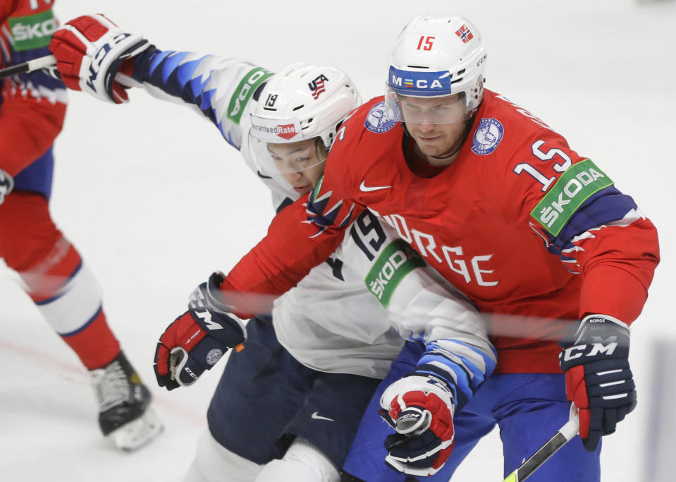 Jason Robertson of the US, left, challenges for the puck with Norway's Tommy Kristiansen during the Ice Hockey World Championship group B match between Norway and United States at the Arena in Riga, Latvia, Saturday, May 29, 2021. (AP Photo/Sergei Grits)
