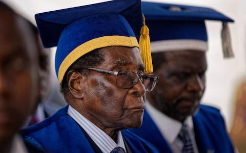 Zimbabwe's President Robert Mugabe leaves after presiding over a student graduation ceremony at Zimbabwe Open University - Credit: AP Photo/Ben Curtis