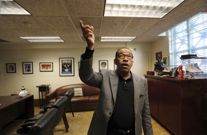 Los Angeles City Council President Herb Wesson describe how members of his staff had heard rustling in the over the ceiling tiles, presumably from rats, after carpet had been removed from his office due to vermin infestation at City Hall Thursday, Feb. 7, 2019.(Reed Saxon/AP Photo)