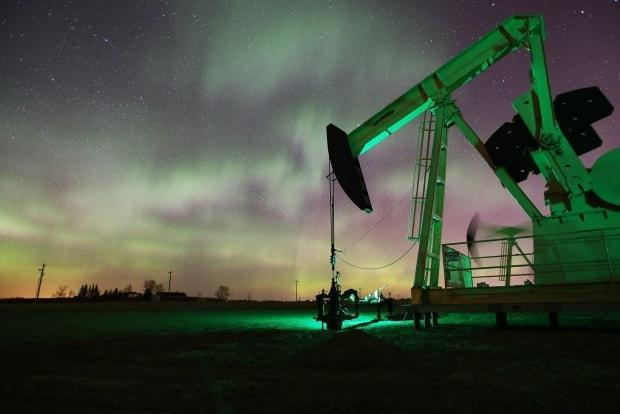 An oil pumpjack northwest of Calgary is shown. Quebec's public pension fund says it plans to sell all the shares in oil companies that it owns by next year. (Robson Fletcher/CBC - image credit)