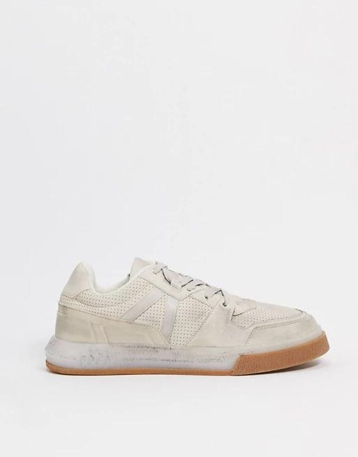 <p>Even the gum sole on these comfortable <span>ASOS Design Distressed Sneakers</span> ($26, originally $56) has some wear.</p>