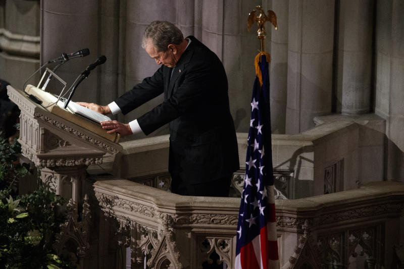 Former President George W. Bush fights back tears as he speaks during the state funeral for his father, former President George H.W. Bush, at the National Cathedral in Washington on Wednesday. (ASSOCIATED PRESS)