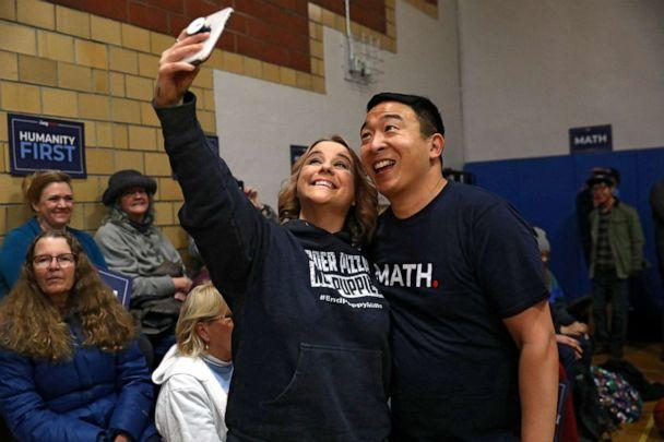 PHOTO: Democratic presidential candidate Andrew Yang takes a selfie with Mindi Callison of Ames after playing basketball with congressional candidate J.D. Scholten in Ames, Iowa, on Dec. 12, 2019. (Brenna Norman/Reuters)