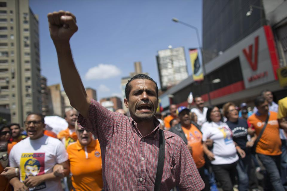 A man shouts slogans against government of President Nicolas Maduro as protesters gather for a demonstration in Caracas, Venezuela, Saturday, April 8, 2017. Opponents of President Nicolas Maduro are preparing to flood the streets of Caracas on Saturday as part of a week-long protest movement that shows little sign of losing steam. (AP Photo/Ariana Cubillos)
