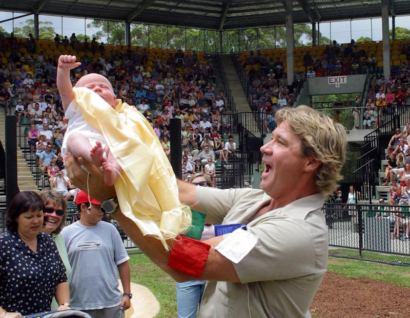 Steve Irwin holding newborn son Bob (1 month) after a blessing ceremony by Tibetan Buddhist nuns at his Australia Zoo at Beerwah on the Sunshine Coast, Australia.
