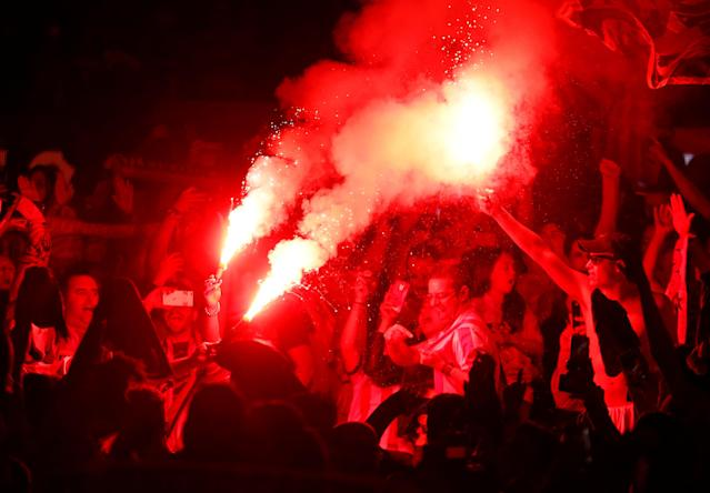 Soccer Football - Europa League Final - Atletico Madrid fans watch the final - Olympique de Marseille vs Atletico Madrid - Wanda Metropolitano, Madrid, Spain - May 16, 2018 Atletico Madrid fans celebrate with flares REUTERS/Juan Medina