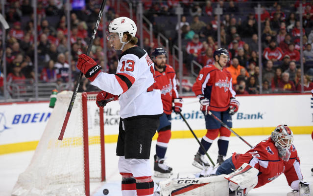 New Jersey Devils center Nico Hischier (13) celebrates his goal against Washington Capitals goaltender Braden Holtby (70) during the first period of an NHL hockey game Saturday, April 7, 2018, in Washington. (AP Photo/Nick Wass)