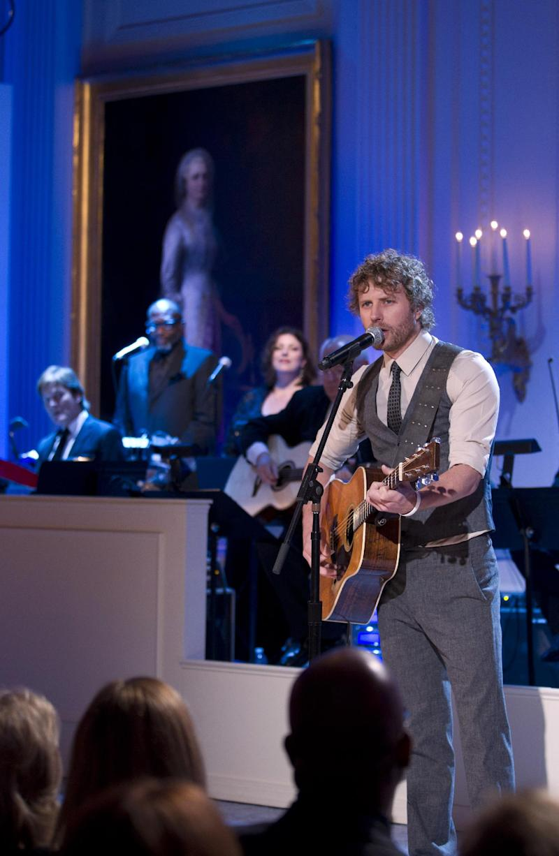 Musician Dierks Bentley performs for President Barack Obama and first lady Michelle Obama during a celebration of country music event in the East Room of the White House on Monday, Nov. 21, 2011, in Washington.  (AP Photo/Evan Vucci)