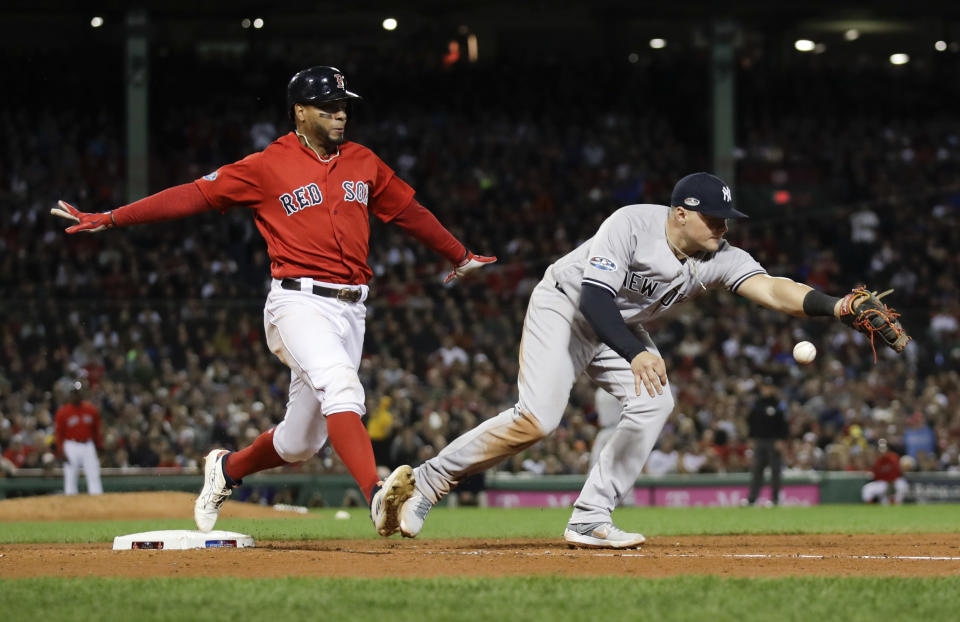 New York Yankees first baseman Luke Voit, right, fails to hang on to the throw after a single by Boston Red Sox's Xander Bogaerts during the fifth inning of Game 1 of a baseball American League Division Series on Friday, Oct. 5, 2018, in Boston. (AP Photo/Charles Krupa)