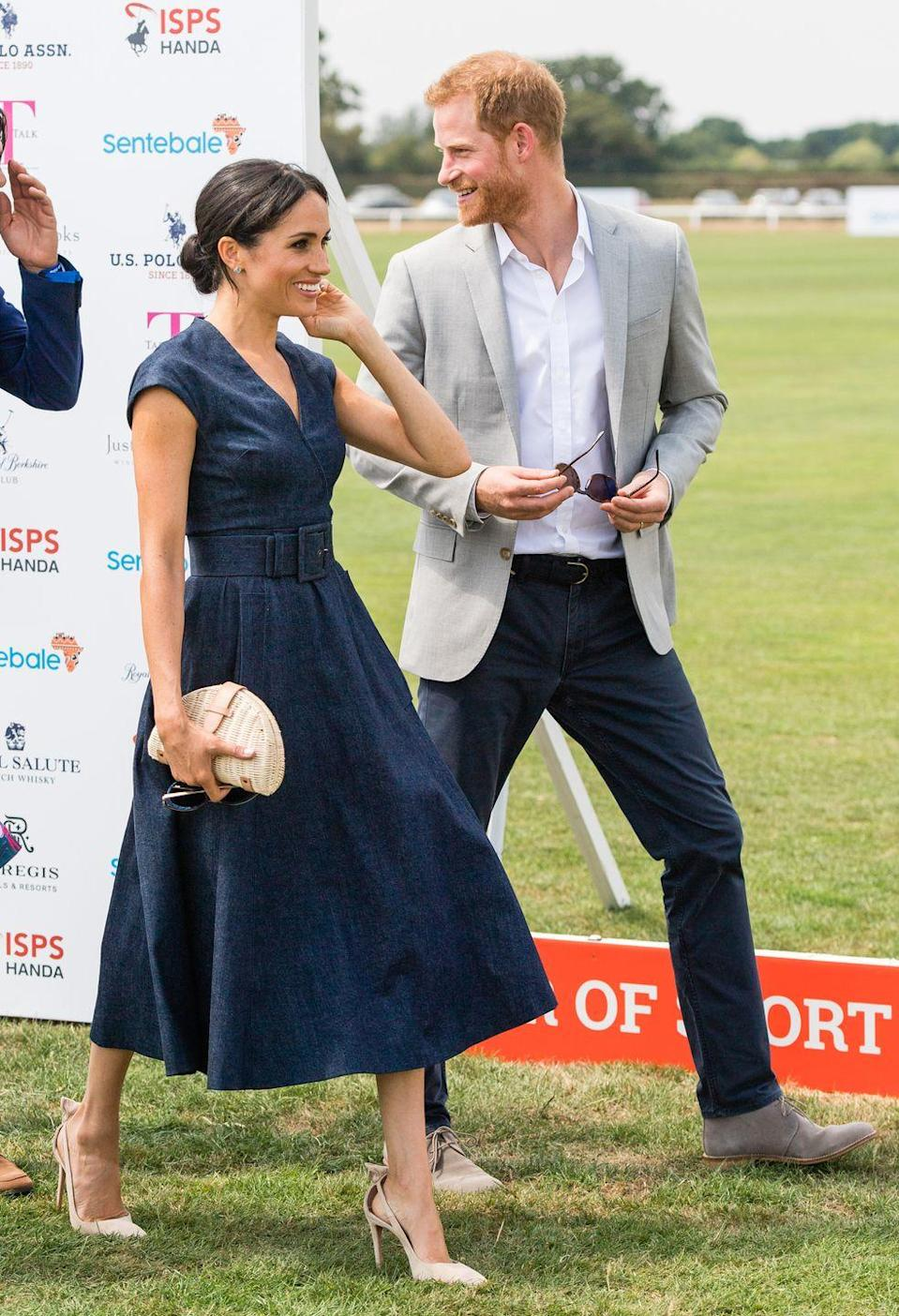 <p>Denim? At the polo? Meghan Markle made it work, in her belted A-line midi dress with cap sleeves. Complete with a straw clutch and nude high heels, she was the picture of smart summer elegance.</p>