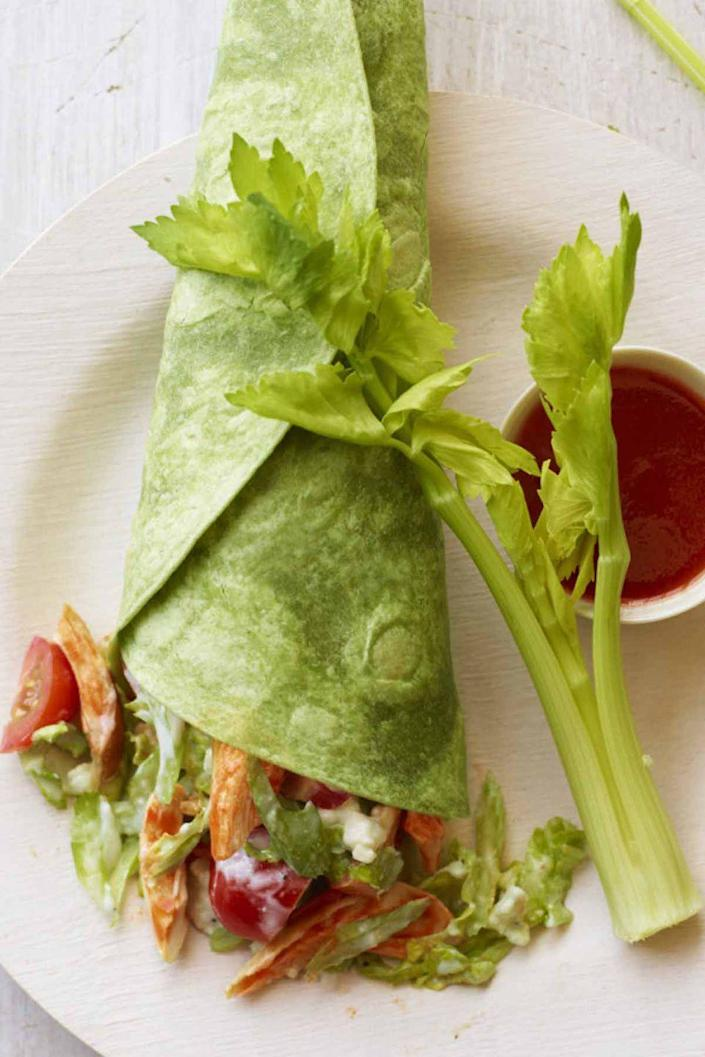 """<p>With celery and blue cheese in the mix of ingredients, this buffalo chicken wrap is both spicy and cool!<br></p><p><a href=""""https://www.womansday.com/food-recipes/food-drinks/recipes/a38959/buffalo-chicken-wraps-recipe-ghk0812/"""" rel=""""nofollow noopener"""" target=""""_blank"""" data-ylk=""""slk:Get the recipe for Buffalo Chicken Wraps."""" class=""""link rapid-noclick-resp""""><u><em>Get the recipe for Buffalo Chicken Wraps.</em></u></a></p>"""