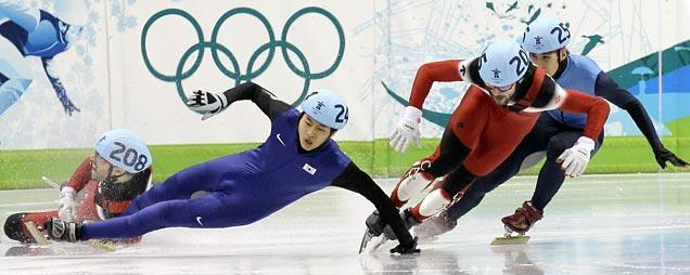 Canada's Francois-Louis Tremblay, left, and South Korea's Sung Si-Bak, second from left, crash as Canada's Charles Hamelin, second from right, and USA's Apolo Anton Ohno, right, are seen during the men's 500m finals short track skating competition