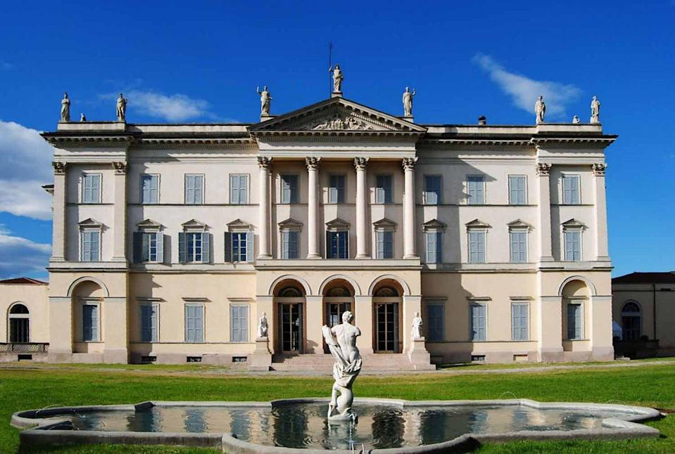 <p>This neoclassical villa was built in 1776 by architect Giuseppe Piermarini in a neoclassical style in the northern Italian town of Desio. The façade, which features Corinthian pilasters and roof statuary, was added in the 1840s by architect Pelagio Palagi. Today, the villa is home to a library and museum named after Giuseppe Scalvini.</p>