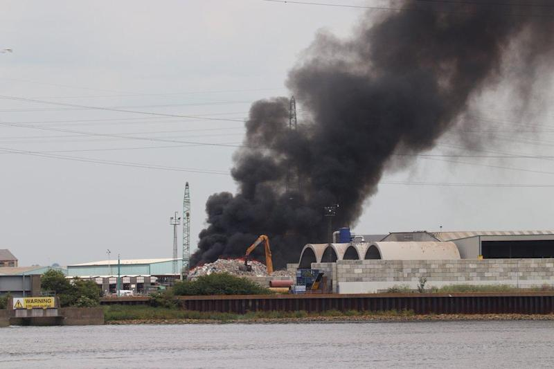 Flames could be seen rising from the waste as black smoke filled the air: Twitter/@TeamMCS