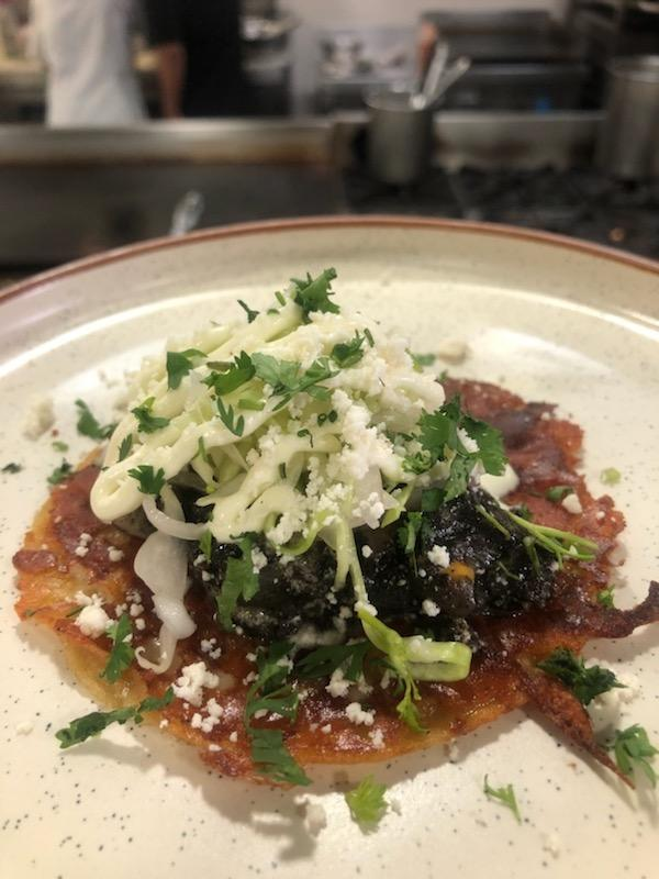 <p>Makes 2 servings<br />2 corn tortillas<br />1 ounce mixed cheese<br />3 ounces hutlacoche<br />10g queso fresco<br />salt to taste<br />1 ounces white onion slaw<br />1 ounce huitlacoche crema<br />10g cotija cheese<br />On a hot griddle top place tortillas, add the mixed cheese and flip onto the cheese. Add huitlacoche to the griddle top and mix with queso fresco; add salt. Transfer the tortilla with the burnt cheese (cheese side up) onto a plate. Top with the huitlacoche mix, add white onion slaw, huitlacoche crema and cotija cheese.<br />Recipe courtesy: Chef Jason James Hudanish, Corporate Chef, Xico </p>