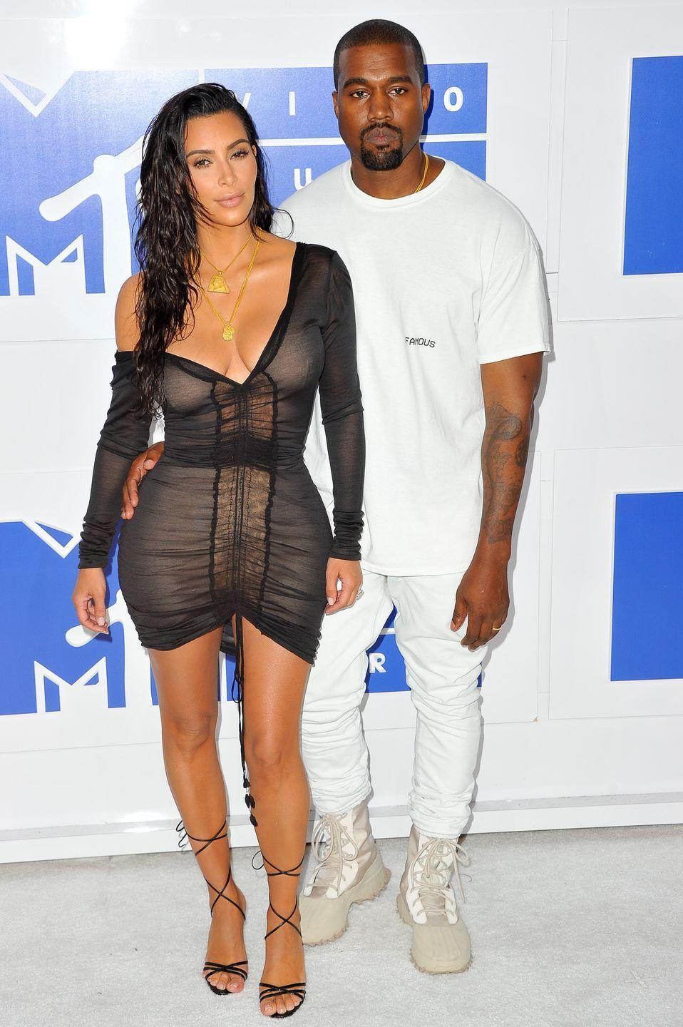 <p>Kim Kardashian's super simple black knit dress look was styled with one shoulder exposed and strappy sandals.</p>
