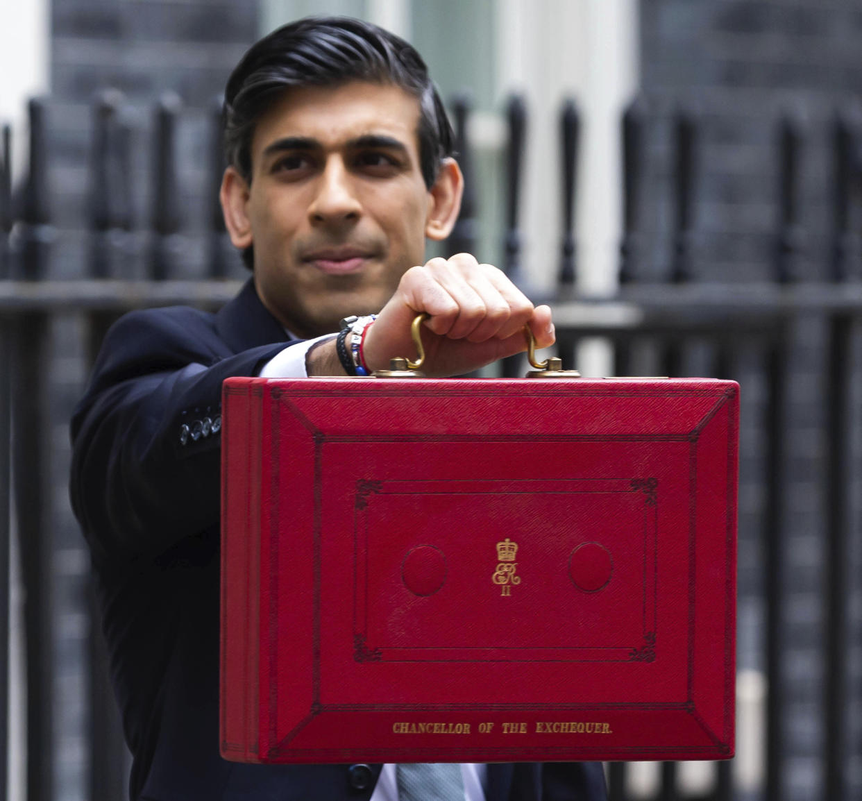 Photo by: zz/KGC-254/STAR MAX/IPx 2021 3/3/21 Chancellor of the Exchequer Rishi Sunak displays the red budget briefcase to waiting media on Downing Street on March 3, 2021. When he delivers his budget to Parliament, The Chancellor is expected to announce billions of pounds in tax cuts and spending increases and maintain numerous other support packages to assist workers, businesses and all citizens as the worldwide coronavirus pandemic continues. (London, England, UK)