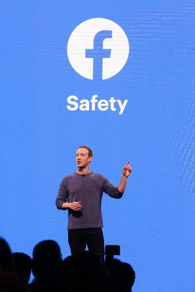 Facebook CEO Mark Zuckerberg said most fake accounts are detected by automated tools and disabled before they can post on the platform (AFP Photo/Amy Osborne)