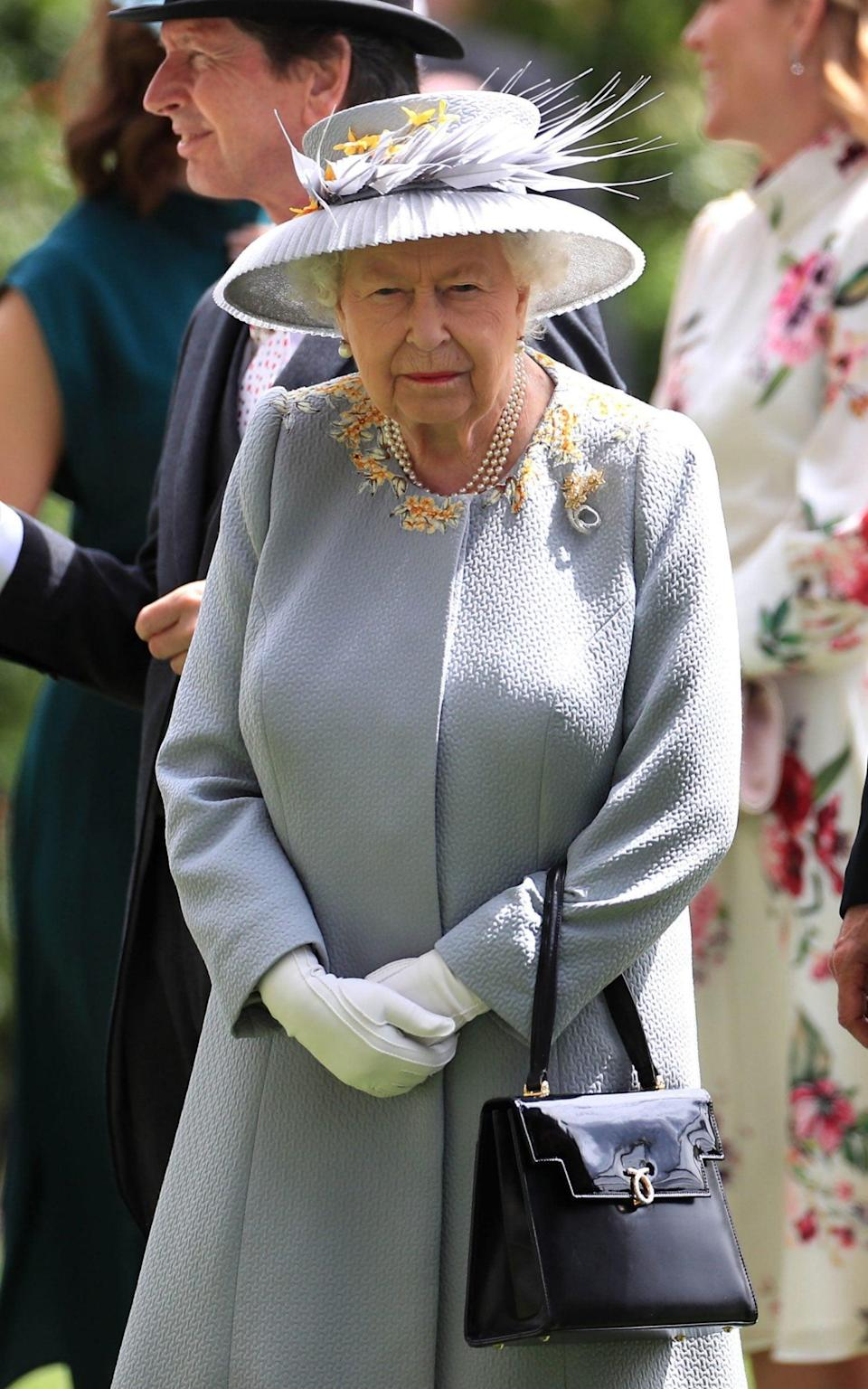 The Queen wearing the same ensemble a Royal Ascot in 2019 - PA