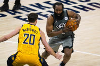 Brooklyn Nets guard James Harden (13) drives on Indiana Pacers forward Doug McDermott (20) during the second half of an NBA basketball game in Indianapolis, Wednesday, March 17, 2021. (AP Photo/Michael Conroy)