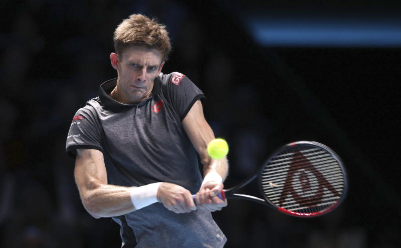 South Africa's Kevin Anderson plays a return to Switzerland's Roger Federer during their ATP World Tour Finals men's singles tennis match at the O2 arena in London, Thursday, Nov. 15, 2018. (John Walton/PA via AP)
