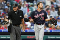 Washington Nationals pitcher Max Scherzer, right, waits to be checked for foreign substances near home plate umpire Tim Timmons after the first inning of a baseball game against the Philadelphia Phillies, Tuesday, June 22, 2021, in Philadelphia. (AP Photo/Matt Slocum)