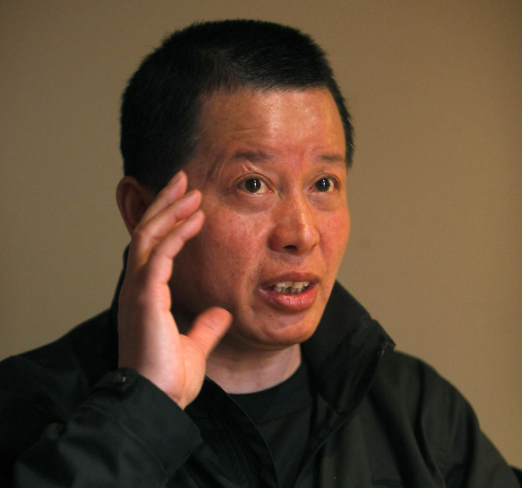 FILE - In this April 7, 2010 file photo, Gao Zhisheng, a human rights lawyer, gestures during an interview at a tea house in Beijing, China. An activist said Gao, one of China's best-known rights lawyers and fiery government critic, has been released from prison but appears to be under close supervision by the authorities. Hu Jia said Gao was freed Thursday, Aug. 7, 2014, from a prison in a remote far-western county and is with his brother. (AP Photo/Gemunu Amarasinghe, File)