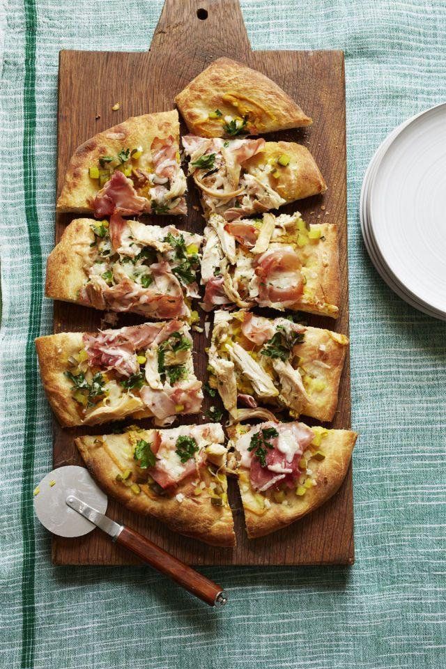 """<p>This pizza, which is topped with chicken, ham, cheese, and pickles, was inspired by the classic sandwich.</p><p><a href=""""https://www.womansday.com/food-recipes/food-drinks/recipes/a56182/pizza-cubano-recipe/"""" rel=""""nofollow noopener"""" target=""""_blank"""" data-ylk=""""slk:Get the recipe for Pizza Cubano."""" class=""""link rapid-noclick-resp""""><em>Get the recipe for Pizza Cubano. </em></a></p>"""