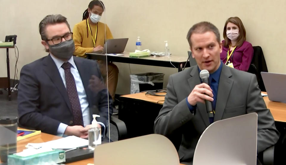 Derek Chauvin speaks to the judge as his lawyer, Eric Nelson, looks on, during his trial on April 15. (Court TV via Reuters Video)