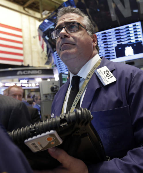 Trader Kenneth Polcari works on the floor of the New York Stock Exchange Wednesday, March 20, 2013. Stocks are opening higher on Wall Street as the European island nation of Cyprus seeks alternatives to a bailout plan its legislature overwhelmingly rejected the day before. (AP Photo/Richard Drew)