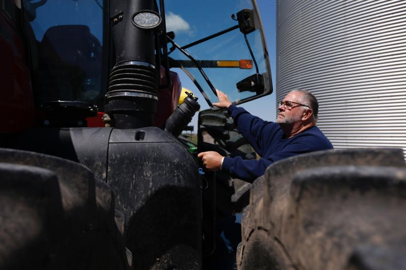 Bret Davis, a soybean farmer, prepares to climb into his tractor in Delaware, Ohio, on Tuesday, May 14, 2019. Some farmers fear the protracted trade war with China will permanently alter their sales, leaving them without a foothold in one of their largest markets. (AP Photo/Angie Wang)