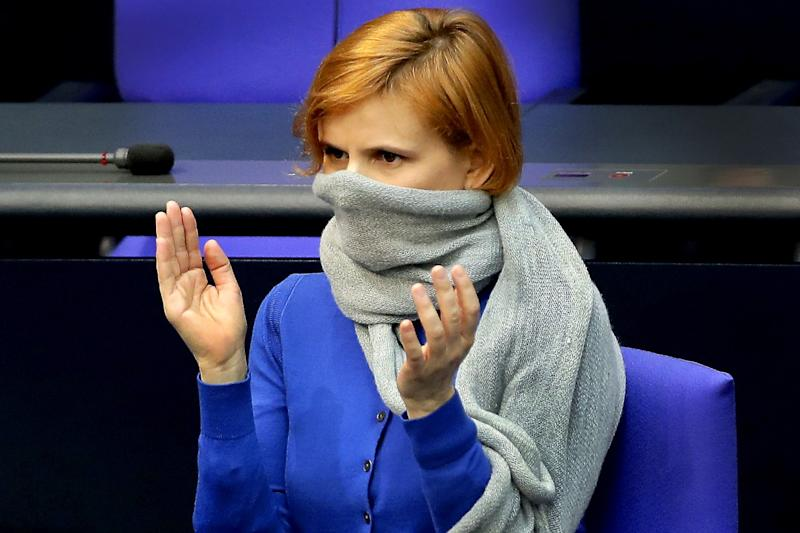 GERMANY: Katja Kipping, co-chairwoman of the German Left Party, wears a scarf as a face mask during a meeting of the German federal parliament, the Bundestag, at the Reichstag building in Berlin.