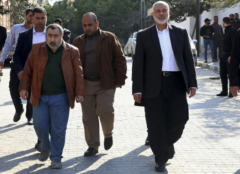 Hamas' supreme leader Ismail Haniyeh, center right, tours destroyed buildings, in Gaza City, Wednesday, March 27, 2019. Haniyeh made his first public appearance since a new round of cross-border violence with Israel this week. On Wednesday he visited the rubble of his Gaza City office, which was destroyed in an Israeli airstrike. (AP Photo/Adel Hana)
