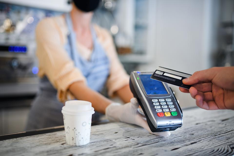 A customer making a contactless payment for a coffee