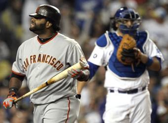 Pinch-hitter Pablo Sandoval returns to the dugout after striking out on three pitches in the eighth inning on Tuesday