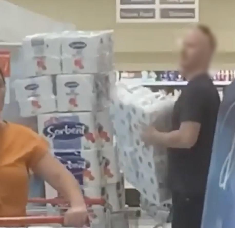 Adelaide Coles shopper piles trolley with toilet paper.