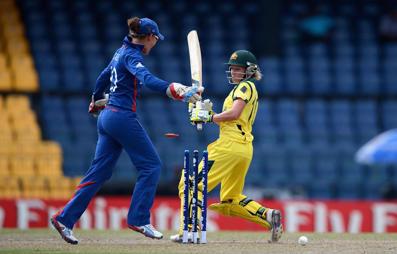 COLOMBO, SRI LANKA - OCTOBER 07:  Alyssa Healy of Australia is bowled by Danielle Hazell of England during the ICC Women's World Twenty20 2012 Final between Australia and England at R. Premadasa Stadium on October 7, 2012 in Colombo, Sri Lanka.  (Photo by Gareth Copley/Getty Images)