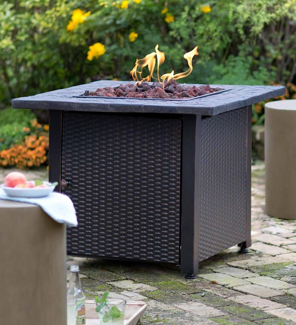 "<p>The best thing about this propane firepit? No cleanup required.</p> <p><strong>BUY IT:</strong> $300; <a href=""https://www.plowhearth.com/en/fireplace-&-hearth/fireplaces,-stoves-&-firepits/fire-pits/wicker-propane-gas-fire-pit/p/13911"" rel=""nofollow noopener"" target=""_blank"" data-ylk=""slk:plowhearth.com"" class=""link rapid-noclick-resp"">plowhearth.com</a></p>"