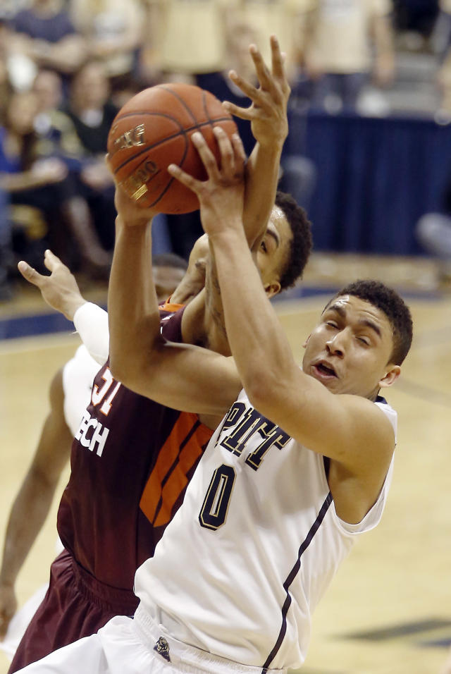 Pittsburgh's James Robinson (0) grabs a rebound in front of Virginia Tech's Jarell Eddie during the second overtime of an NCAA college basketball game on Saturday, Feb. 8, 2014, in Pittsburgh. Pittsburgh won 62-57 in double overtime. (AP Photo/Keith Srakocic)