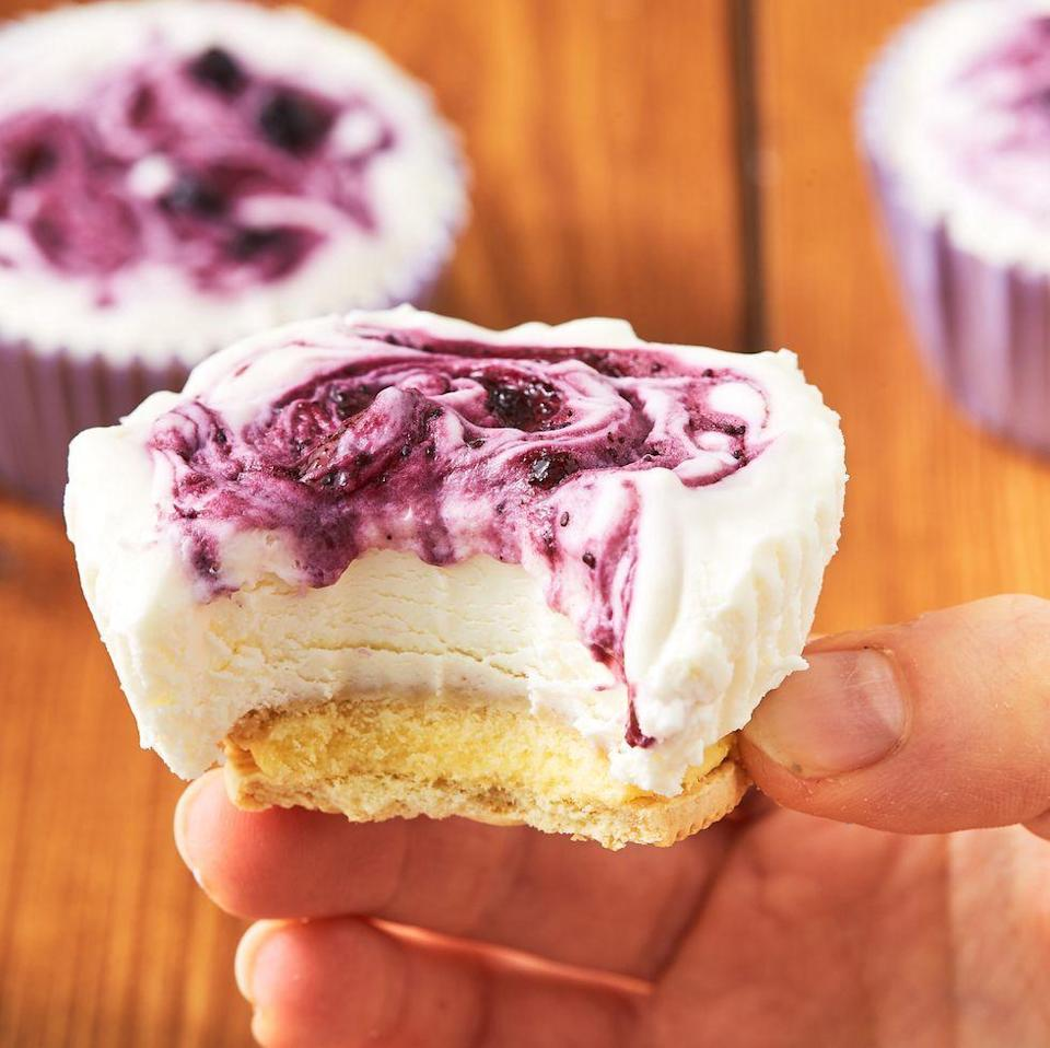 """<p>Mini cheesecakes, MASSIVE flavour. This recipe really has everything you could want. </p><p>Get the <a href=""""https://www.delish.com/uk/cooking/recipes/a32298682/lemon-blueberry-mini-cheesecakes-recipe/"""" rel=""""nofollow noopener"""" target=""""_blank"""" data-ylk=""""slk:Lemon-Blueberry Mini Cheesecakes"""" class=""""link rapid-noclick-resp"""">Lemon-Blueberry Mini Cheesecakes</a> recipe.</p>"""