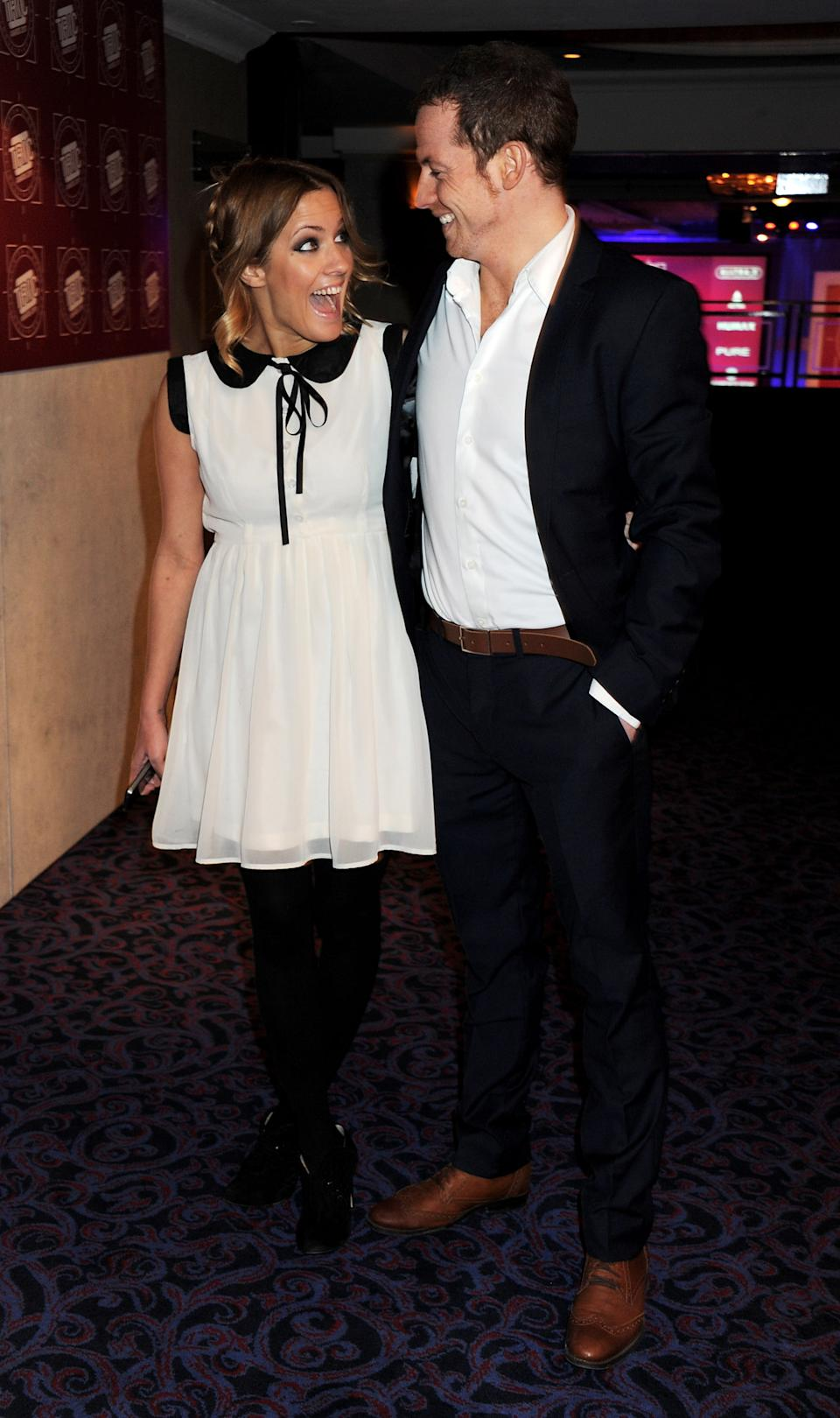 LONDON, ENGLAND - MARCH 08:  (EMBARGOED FOR PUBLICATION IN UK TABLOID NEWSPAPERS UNTIL 48 HOURS AFTER CREATE DATE AND TIME. MANDATORY CREDIT PHOTO BY DAVE M. BENETT/GETTY IMAGES REQUIRED) Presenter Caroline Flack (L) and actor Joe Swash attend the TRIC Television and Radio Industries Club Awards at Grosvenor House on March 8, 2011 in London, England.  (Photo by Dave M. Benett/Getty Images)