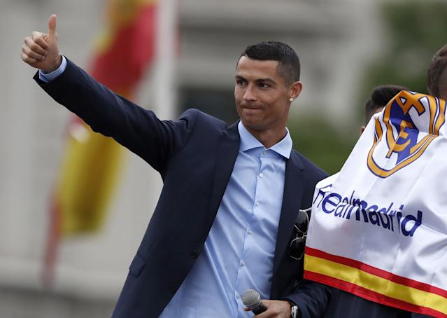<p>Ronaldo gives a thumbs up to supporters. </p>