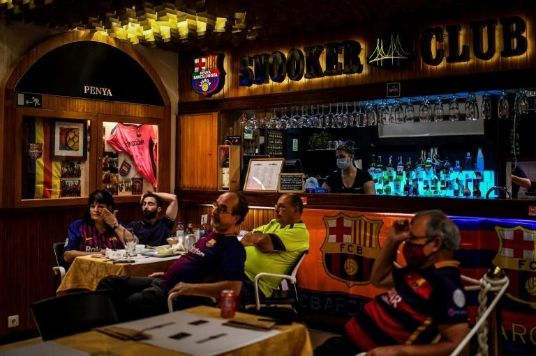 Barcelona fans look glum as they watch the game in a Lisbon bar