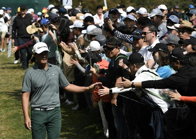 Korean favourite: Seoul-born Danny Lee is mobbed by fans on the eighth hole during the final round of the CJ Cup on Sunday (AFP Photo/Jung Yeon-je)