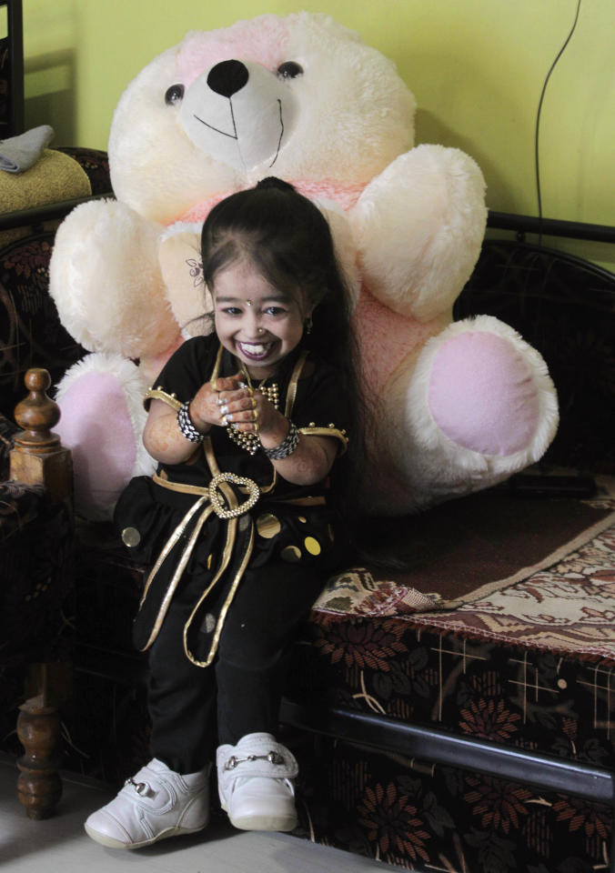 Indian Jyoti Amge, 18, who stands at 61.95 centimeters (2 feet), smiles as she prepares for a press conference with Guinness World Records in Nagpur, India, Friday, Dec. 16, 2011. Officials from Guinness were expected to measure Amge later Friday and declare her the World's Shortest Woman. (AP Photo/Manish Swarup)
