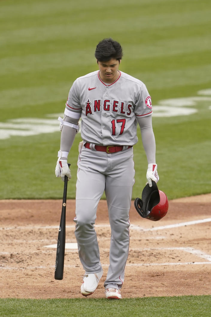 Los Angeles Angels' Shohei Ohtani walks to the dugout after striking out against the Oakland Athletics during the fourth inning of a baseball game in Oakland, Calif., Saturday, May 29, 2021. (AP Photo/Jeff Chiu)